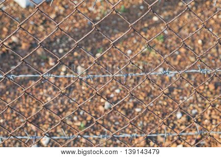 close up rusty barbed wire fence background
