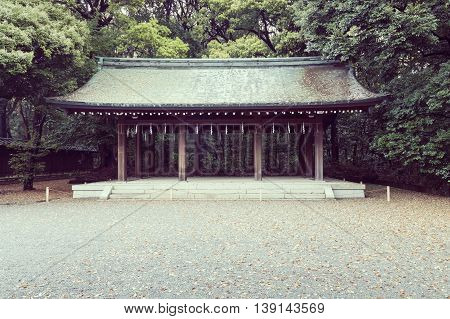 traditional wooden shed in yard of Japanese temple