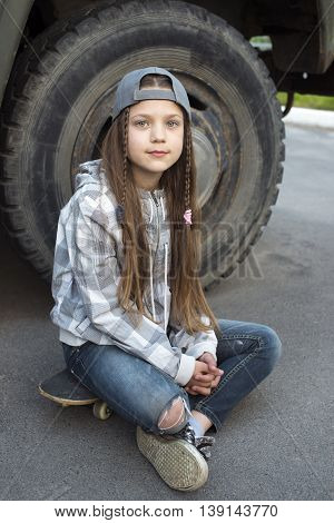Girl Sit On Skateboard