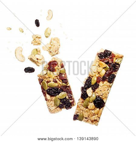 Two Muesli Bar Slice with crumbs isolated on white. Healthy snack fit food concept