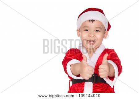 Christmas time - boy with Santa Claus Hat. Young boy as Santa Claus showing OK sign isolated on white background