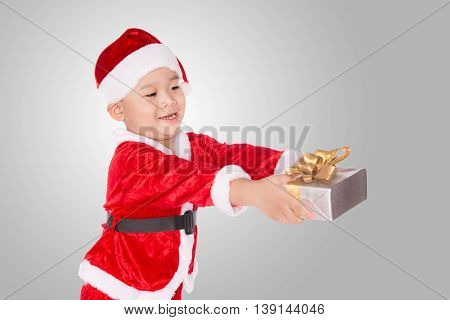 portrait of a surprised little boy with his gift