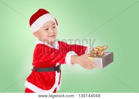 portrait of a happy little boy holding a gift. holidays presents christmas x-mas concept - happy asian child boy with gift box