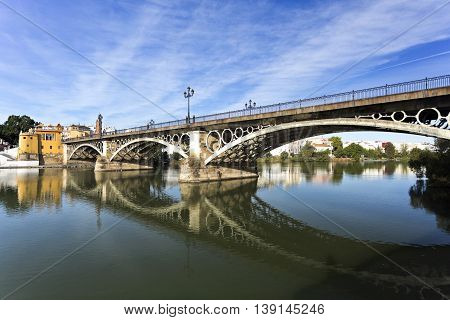 View of the Triana Bridge over the Guadalquivir River in Seville Spain
