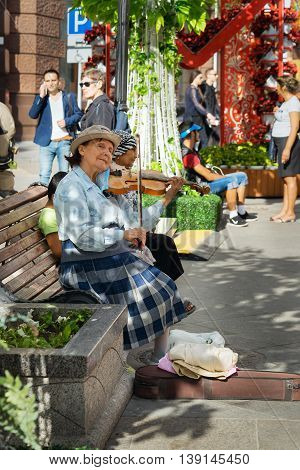 Moscow, Russia - July 10, 2016: Unidentified Old Woman Musician Play Violin In The Street