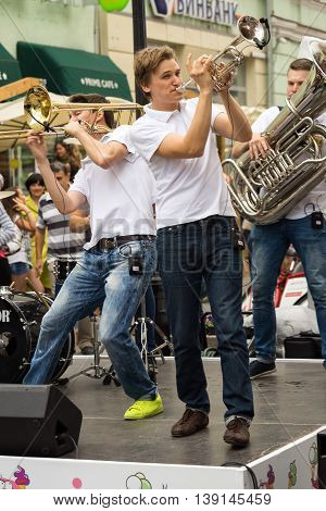 Moscow Russia - July 10 2016: cover band Brevis Brass Band performance on a city street. It is unique Moscow cover team with prodigious energy consisting of a cheerful young people.
