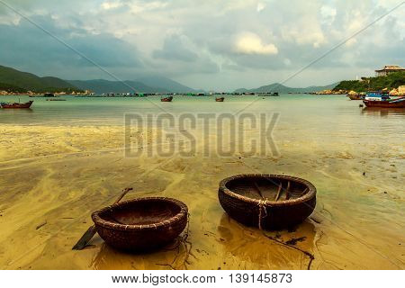 Traditional Vietnamese fishing boats on the shore at low tide in the morning in Vietnam