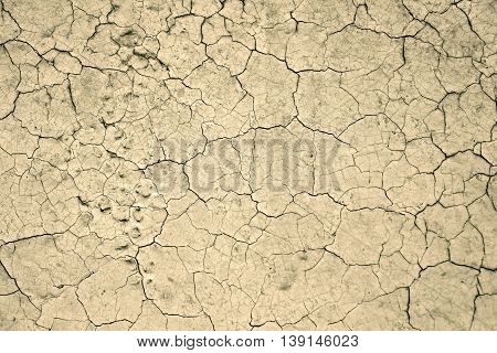 beidge wall background with lot of cracks