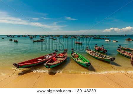A fleet of fishing boats parked at a beach in Vietnam