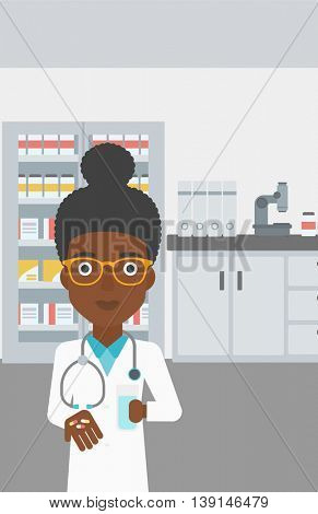 An african-american young female pharmacist with stetoscope wearing medical gown and holding in hands a glass of water and pills in the laboratory. Vector flat design illustration. Vertical layout.