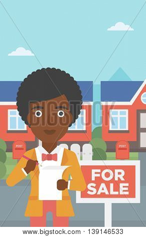 An african-american female real estate agent signing a contract. Young real estate agent standing in front of the house with placard for sale. Vector flat design illustration. Vertical layout.