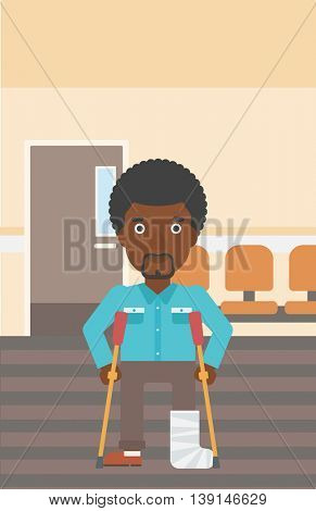 An african-american injured man with leg in plaster using crutches while standing in the hospital corridor. Vector flat design illustration. Vertical layout.