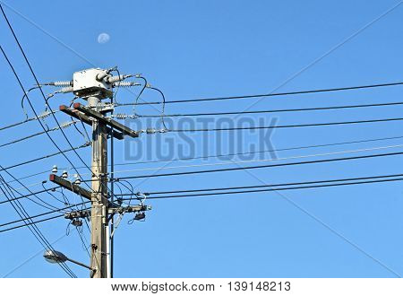 Concrete power pole and lines. Power distribution.