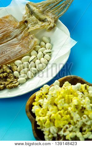 Nuts and dried squid and popcorn