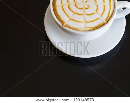 Coffee cup  on back wooden table background, soft focus