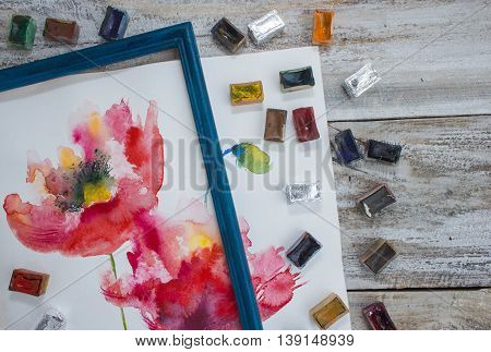 Watercolor paints, brushes, work place artist. Place for text.