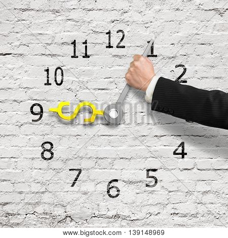 Hand Holding Clock Hands In Usd Money Shape, White Bricks Wall , 3D Rendering