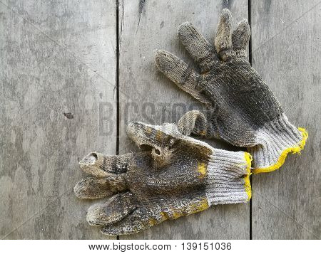 a pair dirty gloves on old wooden background