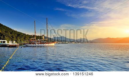 Calm Bay With Clear Water And Anchored Sail Boat. Turkey