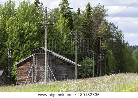 Old telephone lines, wildflower meadows and a wooden, timber barn.