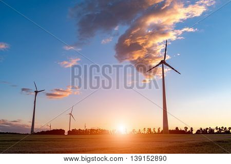 Sunset Above Windmill On The Field