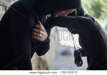 substance abuse, addiction, people and drug use concept - close up of addicts on street