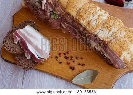 sandwich with smoked bacon. Selective focus. On wooden table. Flat lay.