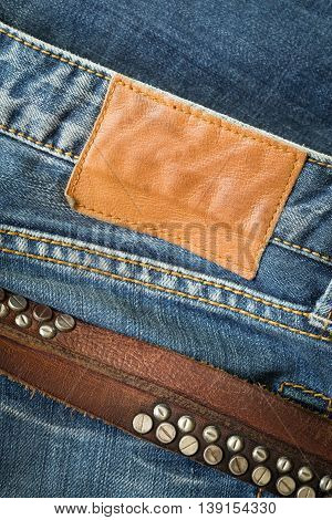 Blue Jeans With Leather Belt And Label Tag