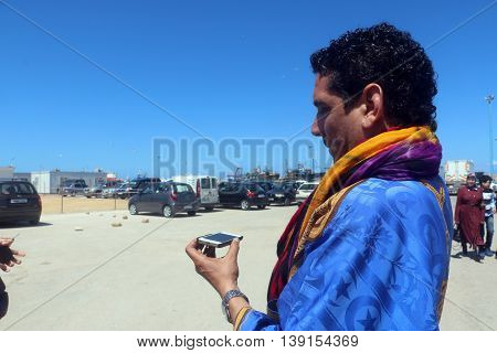 Tourist Guide In The Country Of Morocco Tells Something