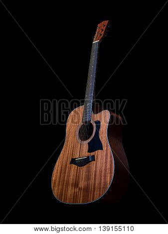 The acoustic guitar on black background, mahogany body