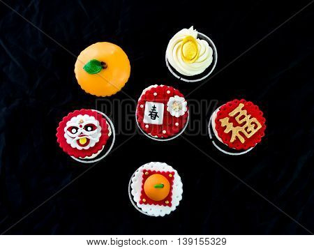 cupcake in chinese theme , black background