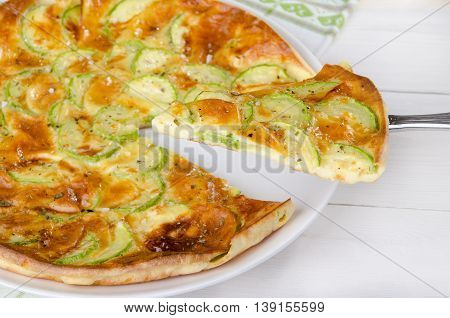 pie with zucchini on a white background, healthy eating