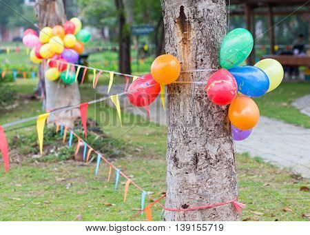 Outdoor Party In Garden Decorated With Colorful Ballons And Flags