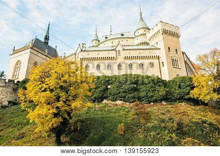 Bojnice castle in Slovak republic. Cultural heritage. Seasonal scene. Yellow autumn trees. Beautiful place. Vibrant colors.