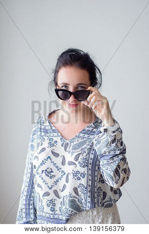 Fashion Girl With In Sunglasses. White Background, Not Isolated