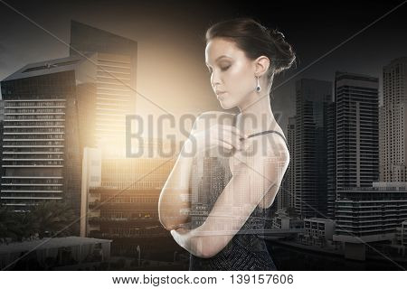 beauty, jewelry, wedding accessories, people and luxury concept - beautiful asian woman with diamond earring over dubai city with double exposure background