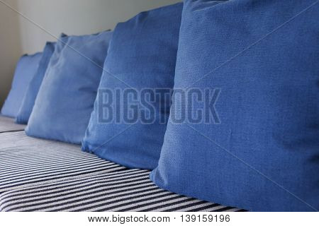 blue pillow on sofa furniture decorated in living room