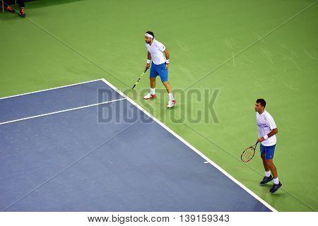 Men Doubles Tennis Players
