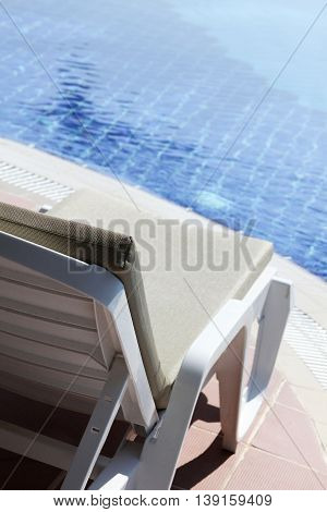 Lounger by the pool. Rest and relaxation