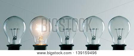 Row of many light bulbs. Idea concept