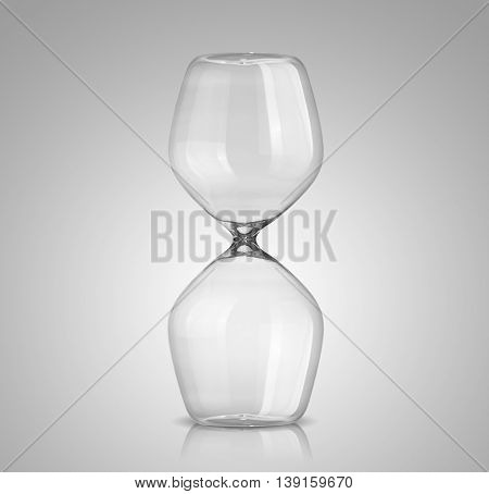 Empty classical hourglass on a gray background