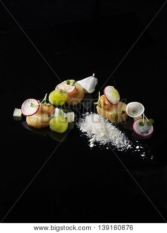 Orkney Islands Scallop Ceviche on black background with white salt