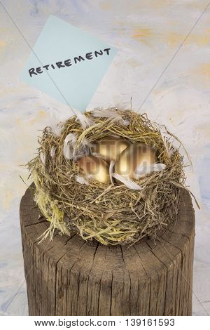 Conceptual image of three golden nest eggs for retirement
