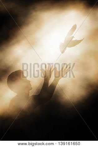 Editable vector illustration of a man releasing a dove into the light created using gradient meshes