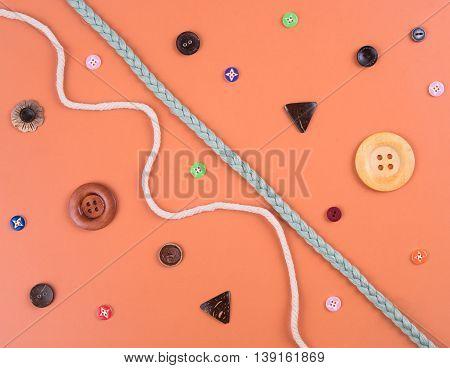 closeup set of button on orange wooden background.
