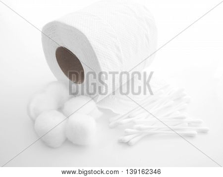 Tissue paper cotton ball and cotton buds on white background