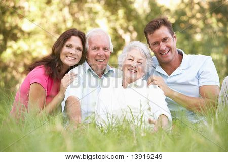 Senior Couple With Grown Up Children In Park