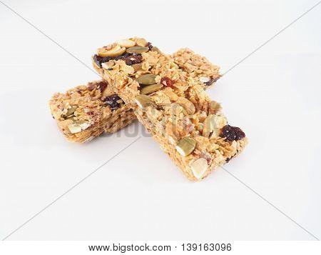 Healthy granola. Organic munchies bars on white background.