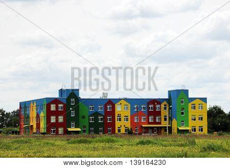 building of a kindergarten in a field of flowers