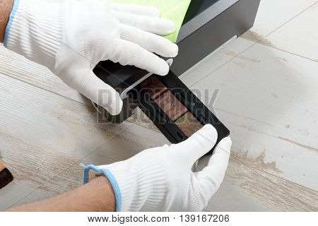 a technician scan a negative film photo